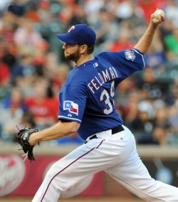 Texas Rangers Scott Feldman throws against the New York Yankees in Arlington