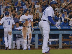 Dodgers' celebrate five-run rally in eighth inning against White Sox in Los Angeles