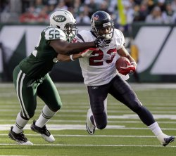 New York Jets Mark Sanchez David Harris tackles Houston Texans Arian Foster at New Meadowlands Stadium in New Jersey