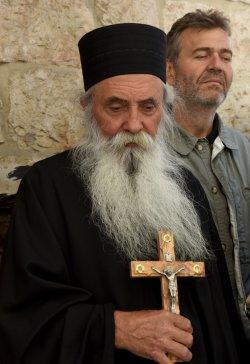 An Orthodox Priest Prays With A Cross On Good Friday, Jerusalem
