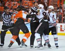 Referees pull apart Flyers Scott Hartnell and Blackhawks' Tomas Kopecky during the 2010 Stanley Cup Final