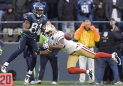 9ers' cornerback Dre' Bly (R) defends Seattle Seahawks' wide receiver Nate Burleson