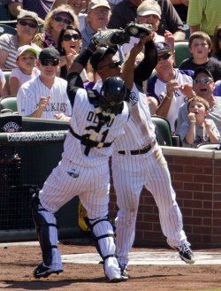 Rockies Olivo and Mora Avoid Collision on Brewers Hart Pop Up in Denver