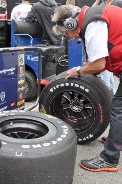 Mario Andretti Examines Grandson Marco Andretti Tires