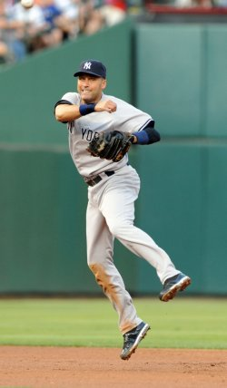 Yankees Derek Jeter throws out Rangers Michael Young in Arlington