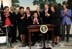 U.S. President Barack Obama signs the Ryan White HIV/AIDS treatment extension act
