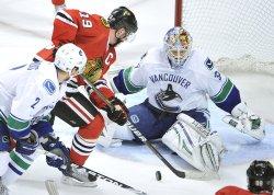 Canucks Schneider makes save on Blackhawks Toews shot in Chicago