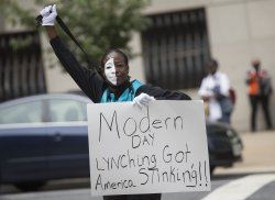 Demonstrators protest at Officer Caesar Goodson's trial in Baltimore