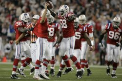 Patriots celebrate fumble recovery against Buffalo at Gillette Stadium.
