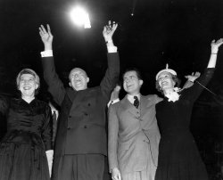 Dwight Eisenhower with his wife Mamie and Richard and Pat Nixon acknowledging the cheers of his audience at Boston Garden.