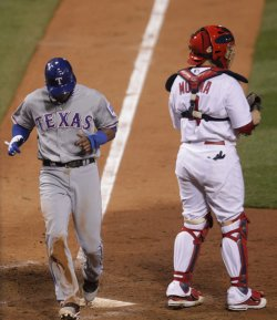 Rangers Elvis Andrus scores during game 2 of the World Series in St. Louis