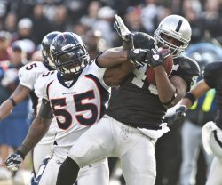 Raiders Marcel Reece grabs a Carson Palmer pass for TD against the Denver Broncos in Oakland, California