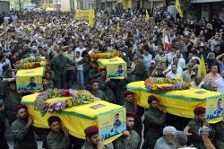 Hezbollah holds a funeral for eight of its fighters killed in the 2006 war against Israel