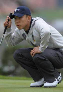 Anthony Kim lines up a putt during the fourth round of the 2009 Presidents Cup in San Francisco