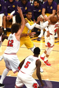 Lakers guard Jordan Clarkson passes the ball around Bulls center Robin Lopez