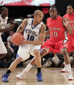 Rutgers Scarlet Knights James Beatty plays defense on Seton Hall Pirates Jordan Theodore at the NCAA Big East Men's Basketball Championships in New York