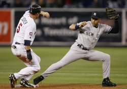 Yankees Jeter forces out Twins Cuddyer during game 3 of the ALDS in Minneapolis
