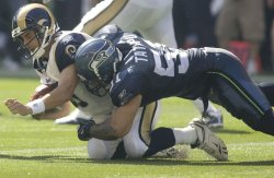 St. Louis Rams quarterback Marc Bulger (L) is sacked by Seattle Seahawks linebacker Lofa Tatupu in the second quarter at Qwest Field in Seattle on September 13, 2009. The Seahawks beat the Rams 28-0.
