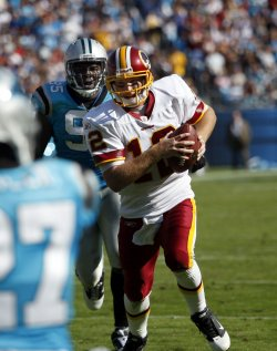 Washington Redskins quarterback John Beck scrambles four yards for a touchdown