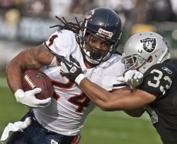 Chicago Bears Marion Barber runs against the Raiders in Oakland, California