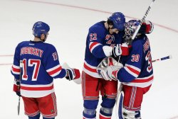 New York Rangers Brandon Dubinsky, Brian Boyle and Henrik Lundqvist react at Madison Square Garden in New York