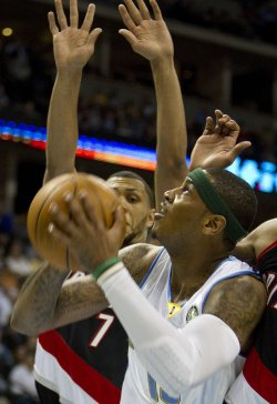 Nuggets Anthony Shoots Against Blazers Roy in Denver