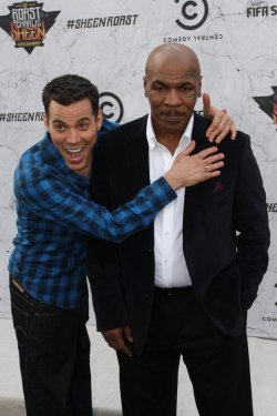 "Steve-O and Mike Tyson arrive at the ""Comedy Central Roast of Charlie Sheen"" in Culver City, California"