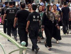 Han Chinese police patrol Urumqi