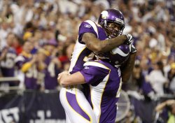 Vikings' Favre and Rice celebrate touchdown against Cowboys in Minneapolis