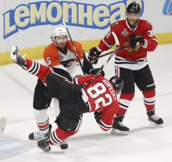 Flyers Coburn checks Blackhawks Kopecky during the 2010 Stanley Cup Final