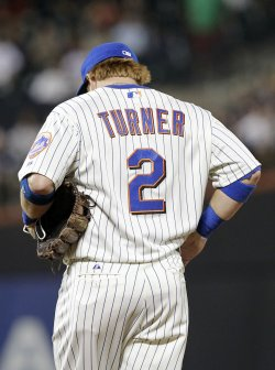 New York Mets Justin Turner reacts after making a throwing error at Citi Field in New York