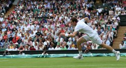 Andy Murray runs for the ball on the second day at Wimbledon Tennis Championships