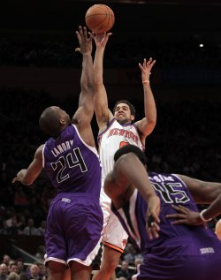 Sacramento Kings Carl Landry tries to block the shot taken by New York Knicks Landry Fields at Madison Square Garden in New York