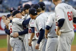 Minnesota Twins manager Ron Gardenhire hugs players after being introduced before the game against the New York Yankees in game 1 of the ALDS at Yankee Stadium in New York
