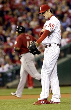 Philadelphia Phillies pitcher Cole Hamels reacts after home run by Houston Astros Carlos Lee