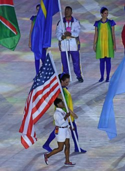 USA's Biles carries flag at Closing Ceremony at the 2016 Rio Summer Olympics