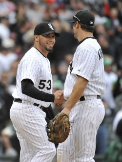 White Sox's Santiago and Konerko Celebrate Win over Tigers in Chicago