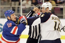 A referee breaks up a skirmish between Atlanta Thrashers Christoph Schubert (16) and New York Rangers Sean Avery in the second period at Madison Square Garden
