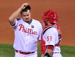 Phillies Joe Blanton meets with Carloz Ruiz during game 4 of the world series in Philadelphia