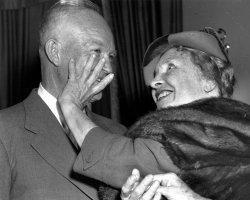 Helen Keller runs her fingers over the face of Dwight Eisenhower.