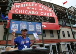 A vendor sells programs prior to White Sox Cubs game