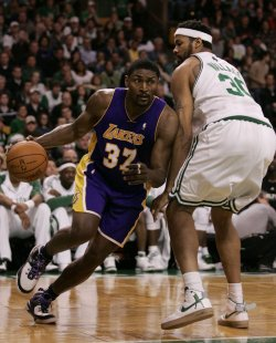 Lakers Artest drives around Celtics Wallace in Boston, MA.