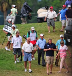 Corey Pavin walks with spectators during the TPC Players in Florida