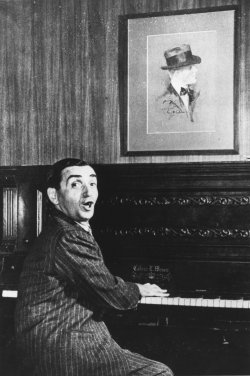 Songwriter Irving Berlin performs on his transposing piano