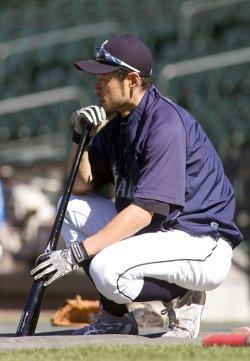 Seattle Mariners' Ichiro Suzuki waits to take batting practice before a game.