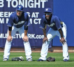 Braun and Morgan wait for pitcher to warm up at spring training in Arizona