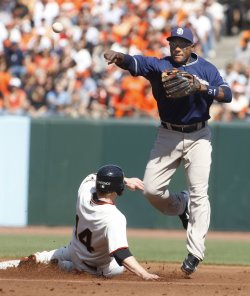 Padres Tejada turns double play against the Giants in San Francisco