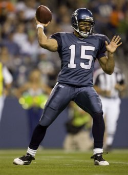 Seattle Seahawks quarterback Seneca Wallace gets set to pass against the Denver Broncos in the third quarter at Qwest Field in Seattle on August 22, 2009.
