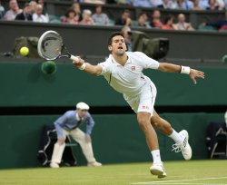 Novak Djokovic returns at 2013 Wimbledon Championships