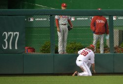 Nationals left fielder Jayson Werth looks for a ball